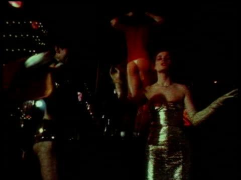 1979 MONTAGE HA WS MS TU LA Couples disco dancing on roller skates in nightclub / London, England