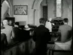Couples entering church INT People standing in church priest at altar CU Elderly couple w/ bible EXT WS Tombstones of British WWI soldiers EXT...