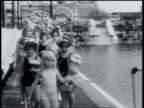 1930 WS Couples get married in swimming pool / New York City, New York, United States