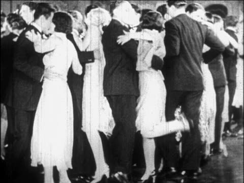 B/W 1926 couples in formalwear dancing Charleston at party / newsreel