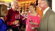 Couples socializing and drinking in restaurant bar