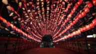 WS, LA Couples walk across a bridge decorated with red lanterns at night / Seoul, South Korea