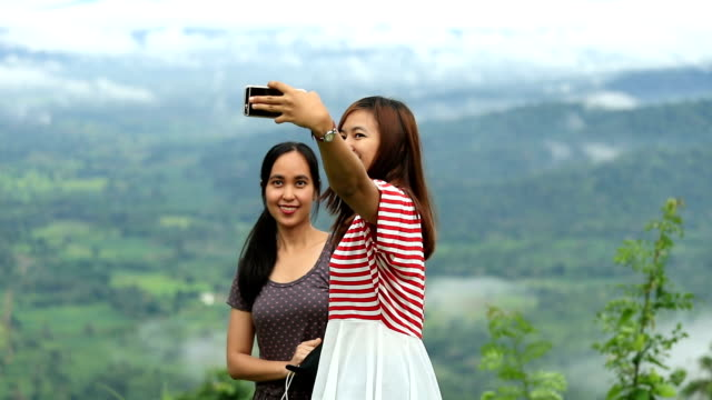 Couples woman Take Selfie Together With Smart phone, Slow motion