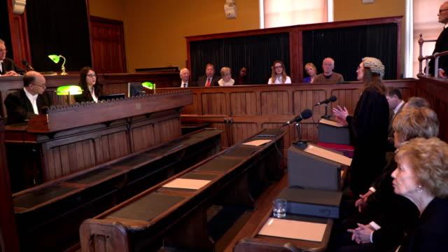 4K: Courthouse - Female Lawyer / Barrister addressing Jury