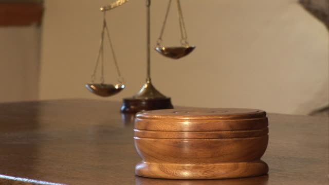 Courtroom, Gavel striking block by Judge with Scales of Justice