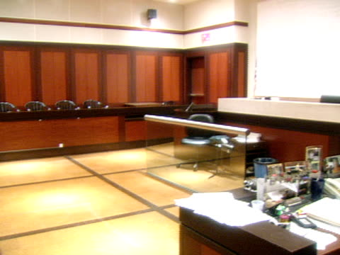 A courtroom sits vacant