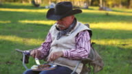 Cowboy eating a steak dinner