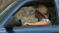 Cowboy picks up businessman hitch hiker