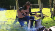 Cowgirl playing Guitar around campfire and Cowboy riding horseback