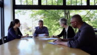 MS Coworkers in discussion at conference table in office/Seattle, Washington, USA