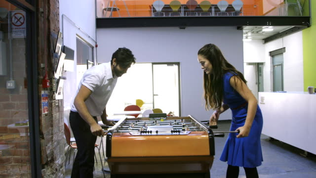 Coworkers Playing Foosball
