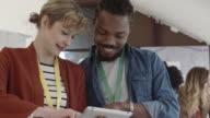 HD: Coworkers Using Digital Tablet.