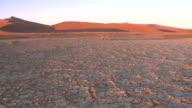 Cracked earth and dune, Sossusvlei, Namib-Naukluft, Namibia