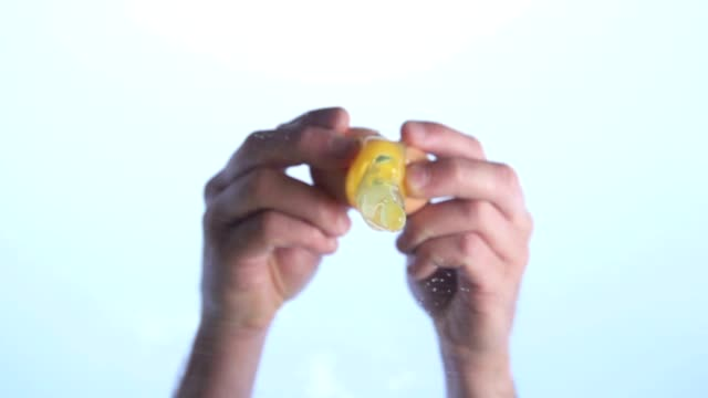 Cracking an Egg in hot sun Slow Motion HD
