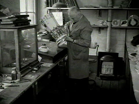 A craftsman finishes off the burnished gold on a commemorative vase to celebrate the Queen's leadership of the Commonwealth