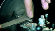 Craftsman polishing metal
