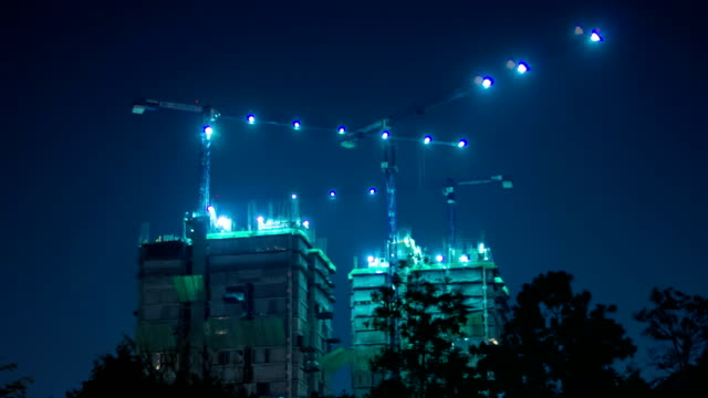 Crane and building construction at night