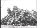 1930 WS Crane lifting and dropping old cars onto large pile / Long Beach, California, USA