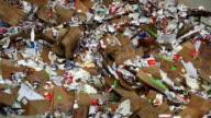 CU Crane Moving Paper Waste in a Recyling Center