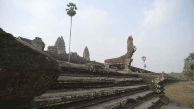 Crane shot down stone steps in the grounds of the Angkor Wat temple in Cambodia.