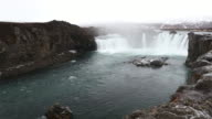 Crane shot: Iceland Godafosss Waterfall in winter with snow