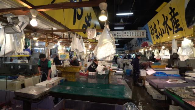 Crane shot Merchant working at Tsukiji Fish Market Tokyo Japan