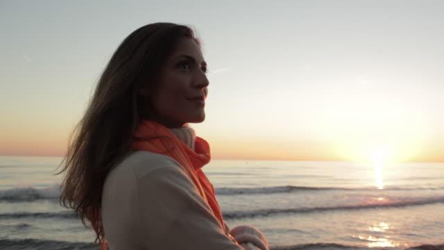 Crane shot of woman standing on beach/Marbella region, Spain