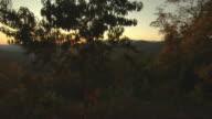 Crane shot, revealing Blue Ridge Mountain sunrise.