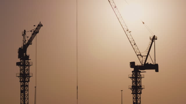 Crane Silhouettes at Constructions Site