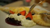 Crape with ice-cream and whipped cream