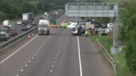 Lorry driver appears in court 2682017 ENGLAND Buckinghamshire Near Newport Pagnell M1 EXT Wide shot of wreckage of FedEx lorry being lifted up by...
