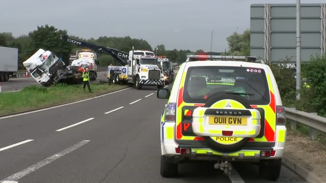 M1 Crash scene and lorries being removed ENGLAND Buckinghamshire Newport Pagnell M1 Motorway EXT GVs crash scene and wreckage of lorry being removed...
