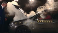 MS TU Crash test dummy on airbag in smoking crash test car / Berlin, Germany