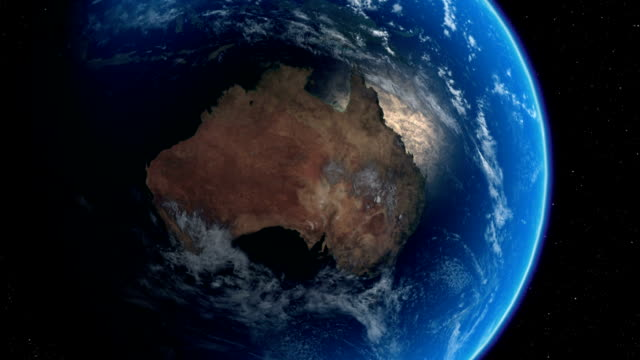 Crash zoom in from space to truck driving through Australian outback. Available in HD.