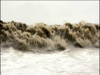 Crashing waves of biggest tidal bore in world Amazon River Brazil