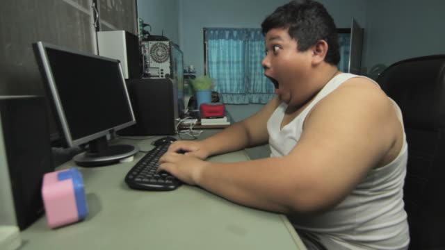 Crazy boy typing keyboard