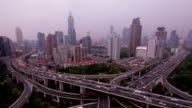 Crazy Highway Intersection Shanghai with Skyline. Day to Night Timelapse.