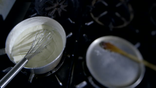 creamy sauce is cooked in a cauldron