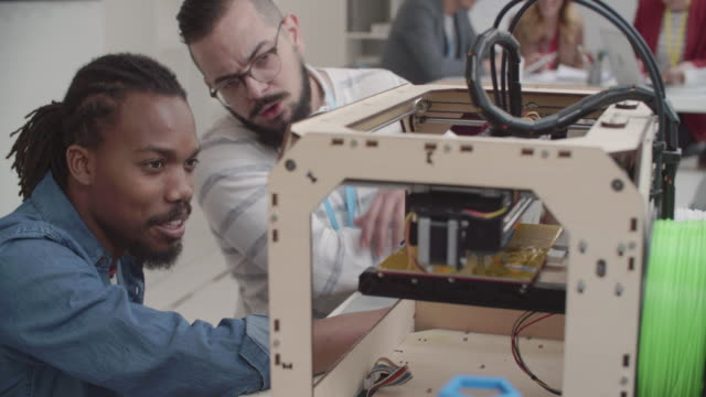 4K: Creative people working in their Startup 3D Printing Office.
