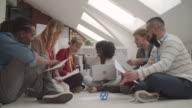 4K: Creative Team Brainstorming On The Floor In Their Office.