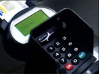 Credit card placed in chip and pin machine and pin number punched into keypad