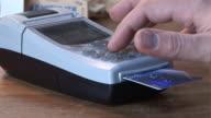 Credit Card Terminal Machine, Man enters Pin Number in Shop