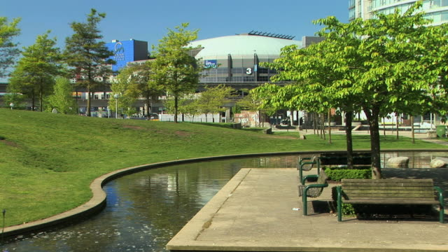 WS Creek in Andy Livingstone park with GM Place in background, Vancouver, British Columbia, Canada
