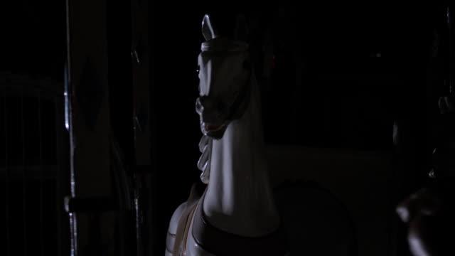 Creepy abandoned carousel at night