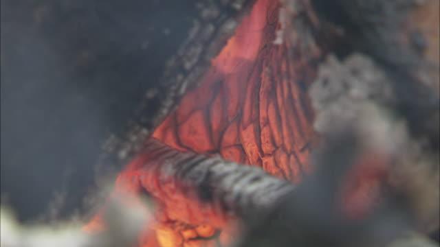 A cremation fire burns.
