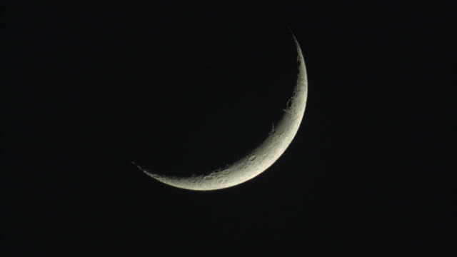 Crescent moon in night sky