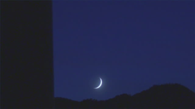 T/L, WS, Crescent moon setting behind hills, North Palm Springs, California, USA