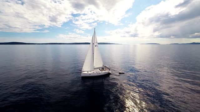 AERIAL WS Crew On A Sailboat In The Sea