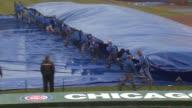 WGN Crew Pulls Tarp Off Wrigley Field Baseball Diamond at Wrigley Field on April 08 2013 in Chicago Illinois