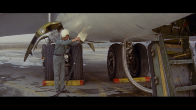 MS PAN Crews plugging in apus for starting engines on b-52 military jet bomber airplane